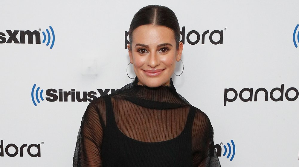 Lea Michele smiling, hair in low ponytail