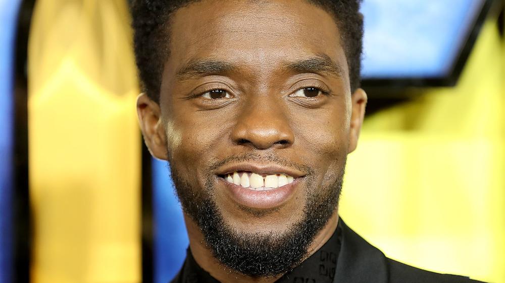 Chadwick Boseman smiling on the red carpet