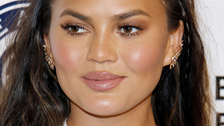 Chrissy Teigen looking to the side with slight smile