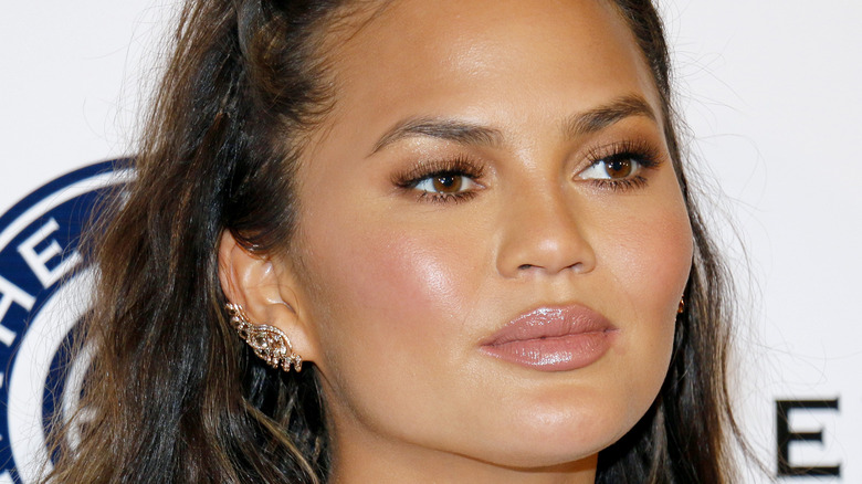 Chrissy Teigen gives a serious look on the red carpet