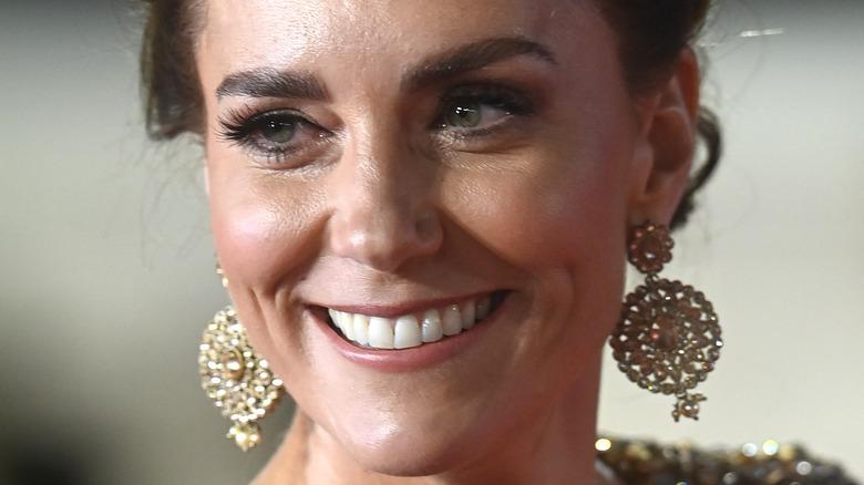 Kate Middleton smiles on the red carpet