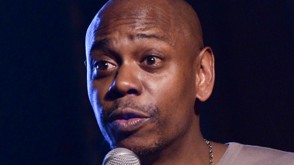 Dave Chappelle performing at an event