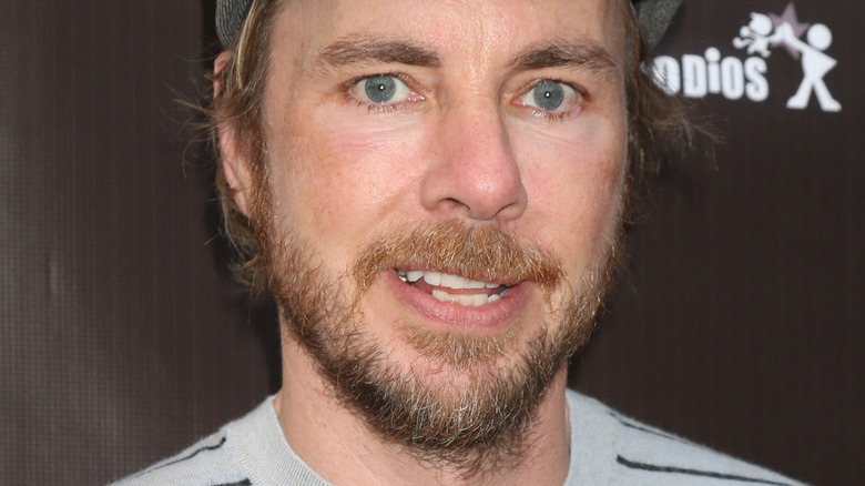 Dax Shepard with beard and slight smile