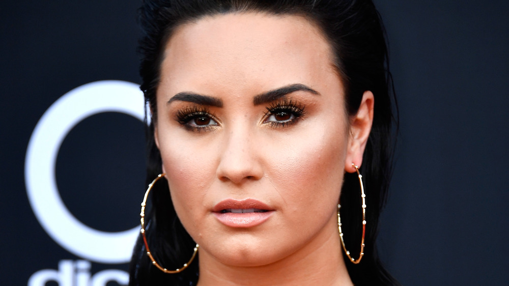 Demi Lovato with a serious expression