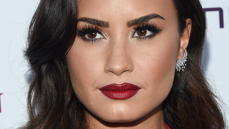 Demi Lovato with a neutral expression