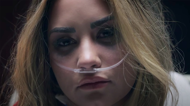 Demi Lovato stars in her new music video, Dancing With the Devil