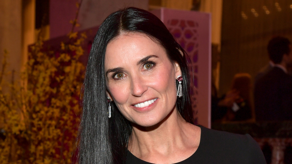 Demi Moore smiles at the camera at an event