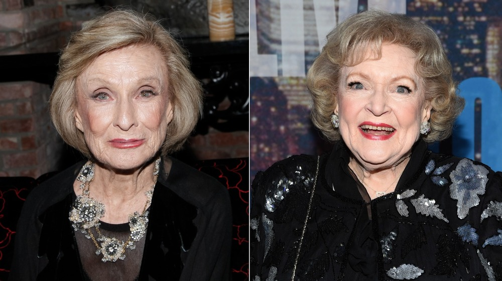 Cloris Leachman (right) smiles for the camera at an event as Betty White does the same on the left