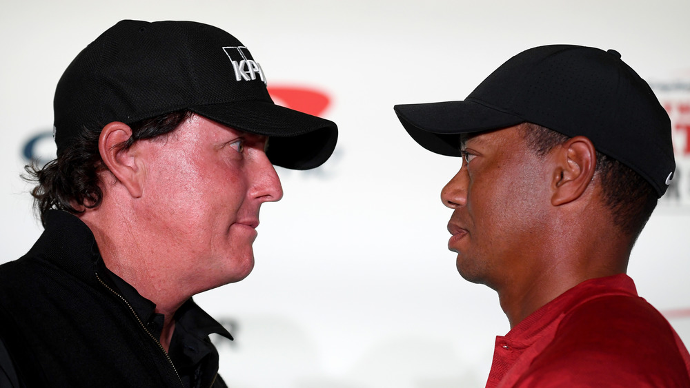 Phil Mickelson and Tiger Woods face off