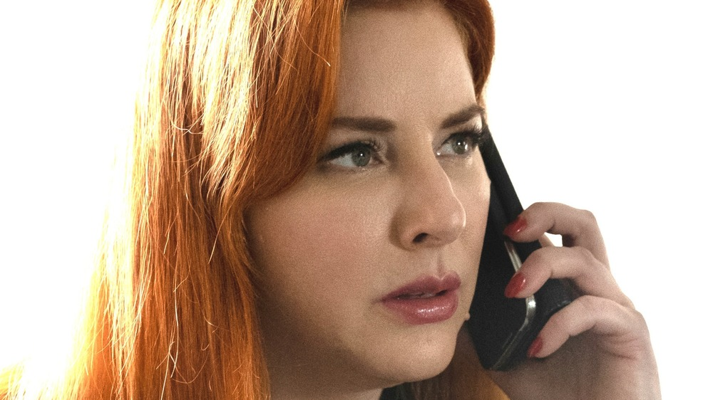 Diane Neal on the phone in Circle of Deception