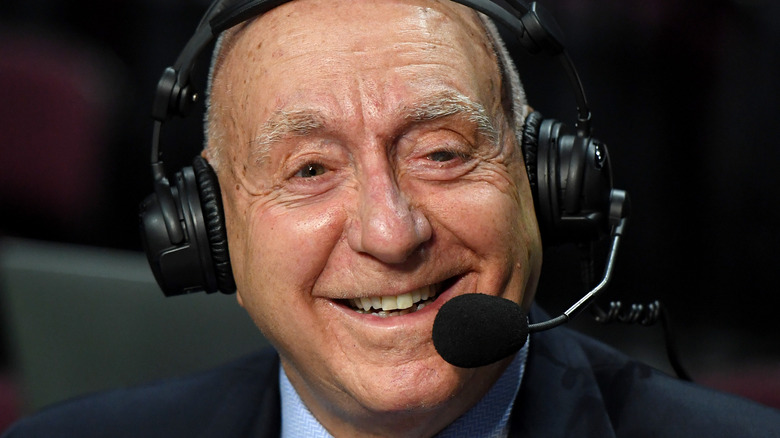 ESPN announcer Dick Vitale smiling, wearing a broadcasting headset