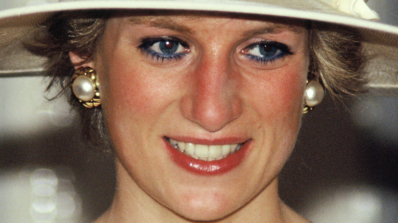 Princess Diana wearing a hat and smiling