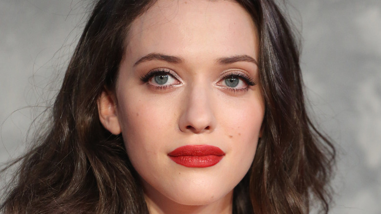 Kat Dennings with bright red lip and mussy hair