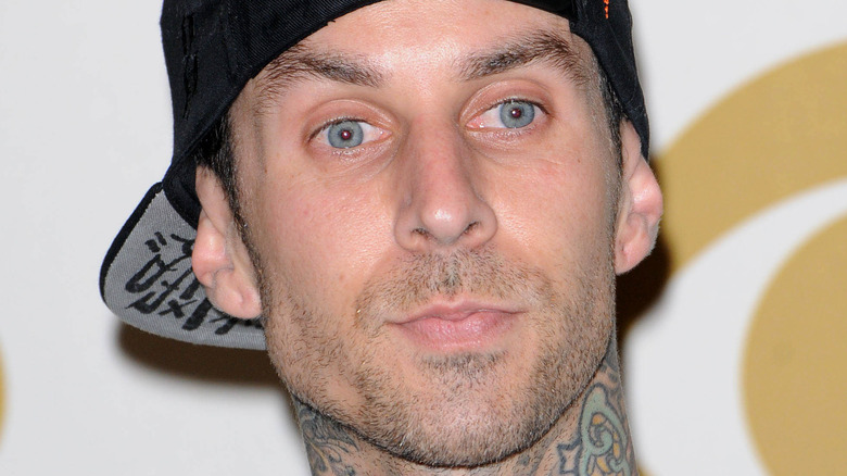 Travis Barker with a serious expression