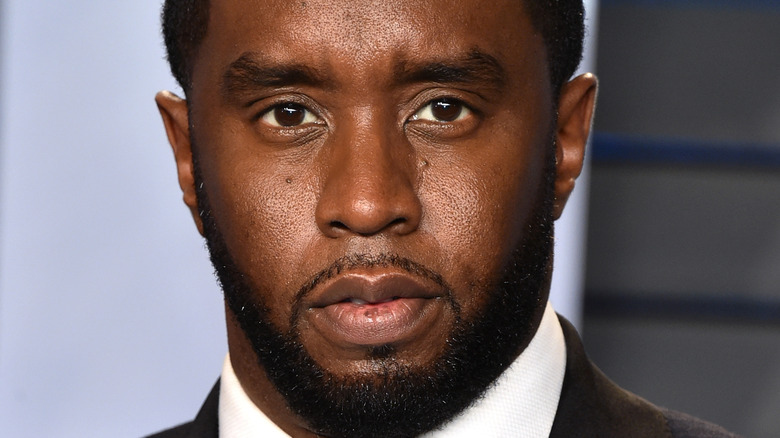 Diddy wearing a suit