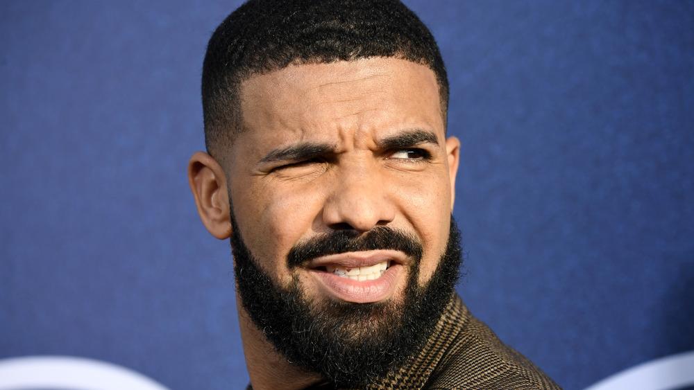 Drake grimacing