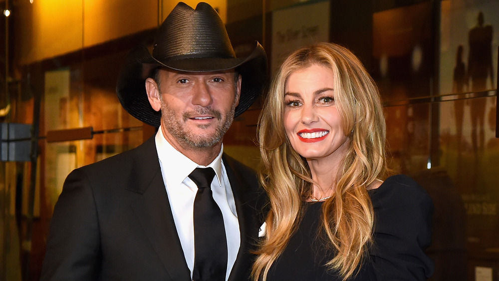 Tim McGraw and Faith Hill smiling at a Hollywood event