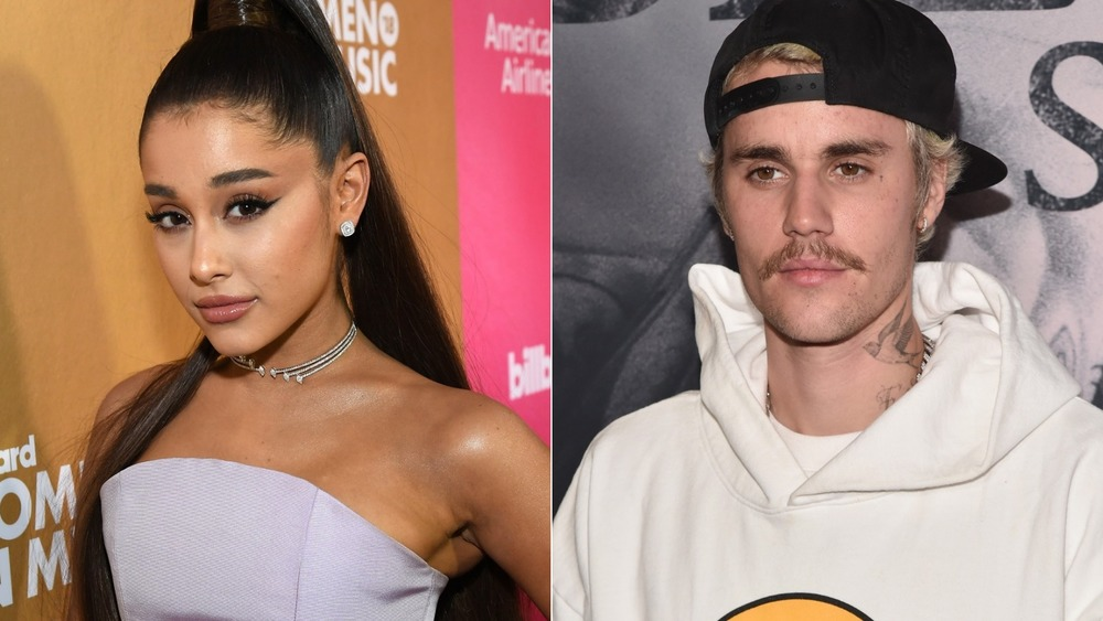 Justin Bieber and Ariana Grande pose on a red carpet