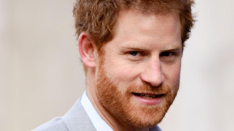 Prince Harry looks sideways at camera