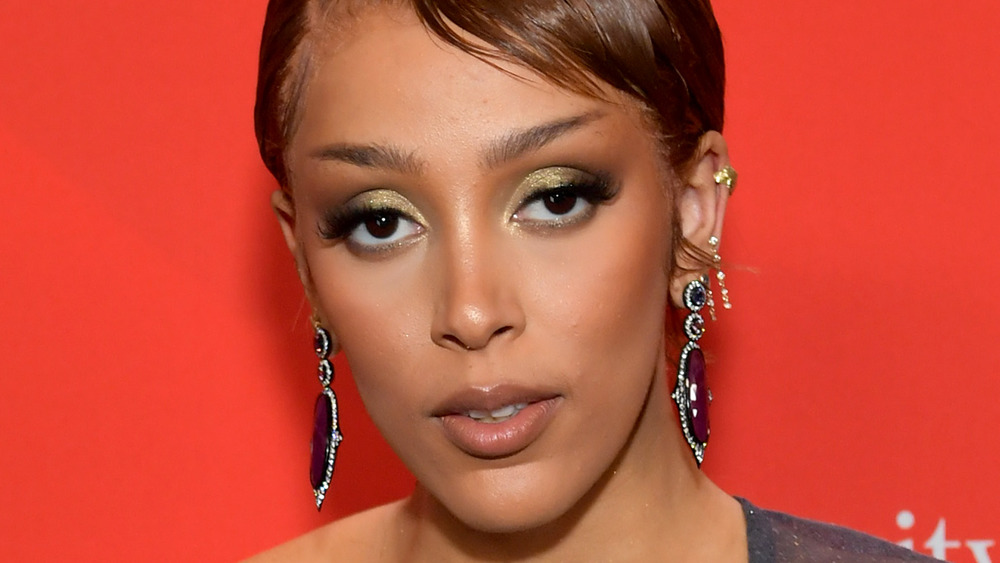 Doja Cat gives a smoldering look on the red carpet