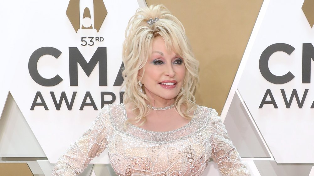 Dolly Parton in white sequinned dress