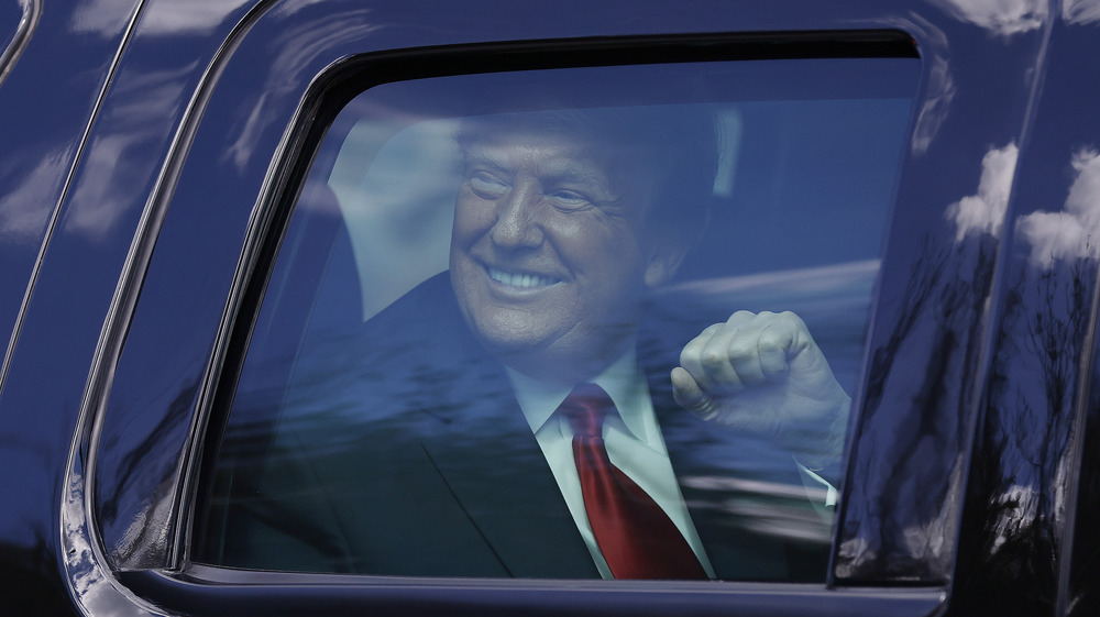Former President Donald Trump in a vehicle