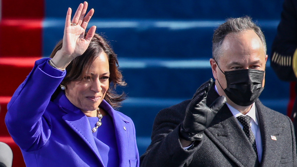 Kamala Harris and Doug Emhoff waving at the inauguration