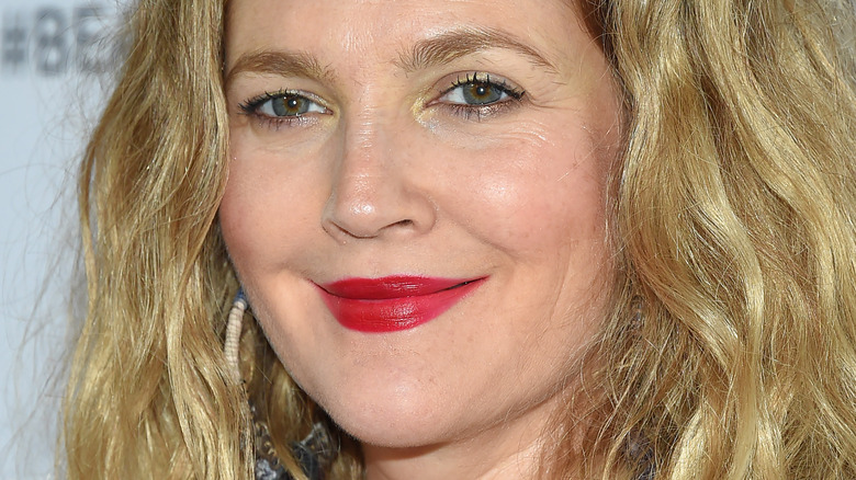 Drew Barrymore smiling on the red carpet