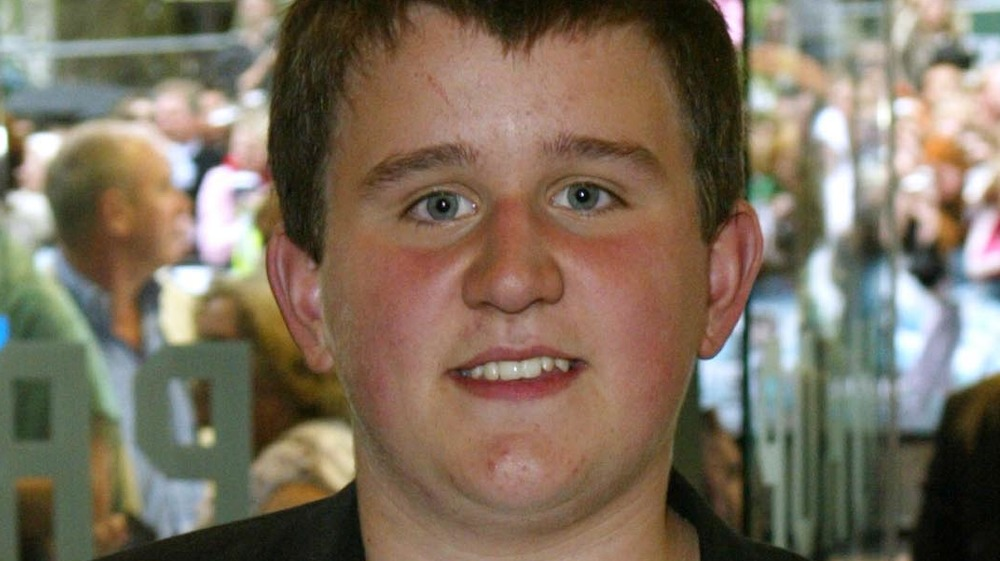 A young Harry Melling smiling