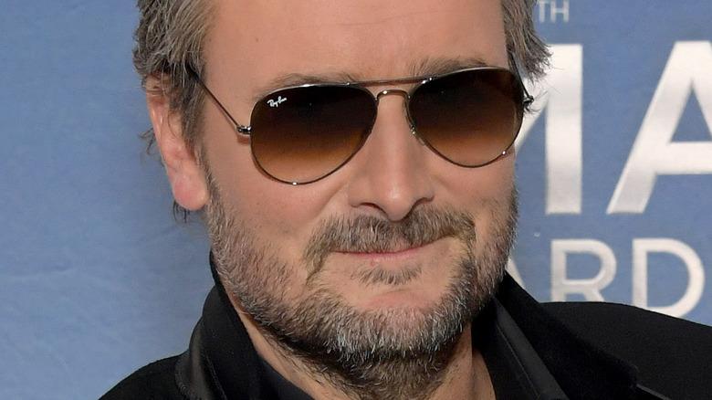 Eric Church smiling wearing sunglasses