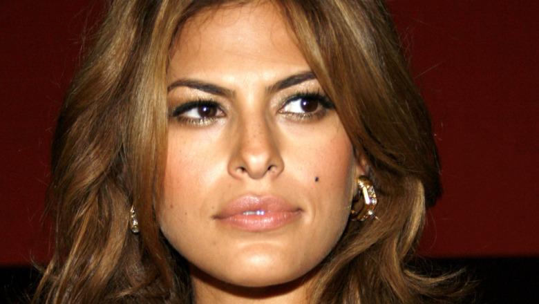 Eva Mendes looking to her left wearing earrings