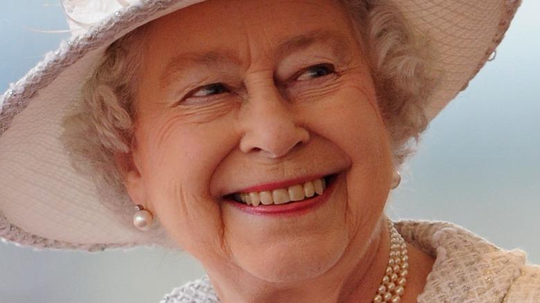 Queen Elizabeth in ivory hat