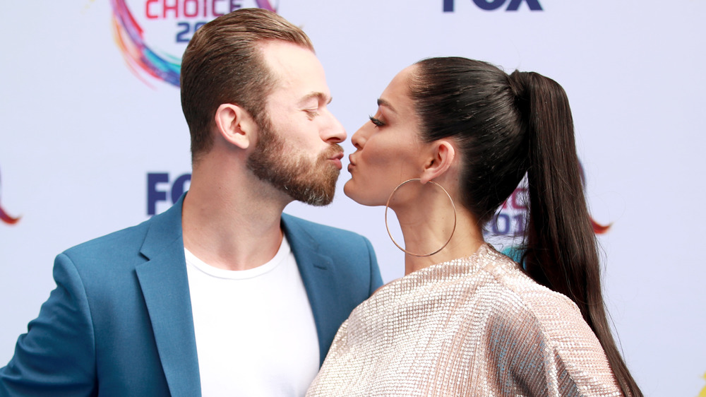 Artem Chigvintsev and Nikki Bella nearly kissing