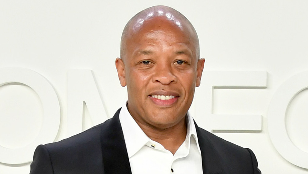 Dr. Dre smiling on the red carpet