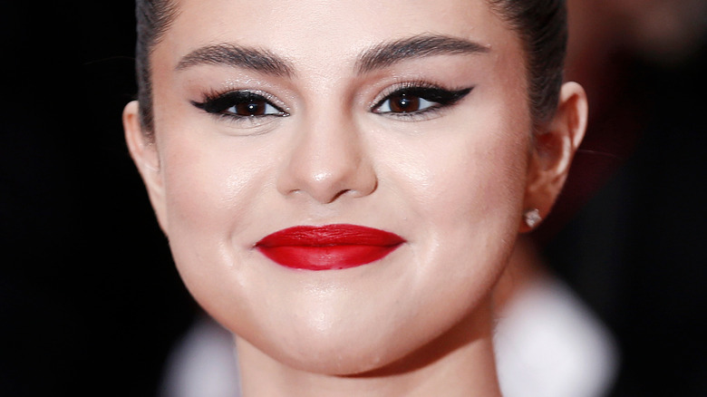 Selena Gomez smiling for the cameras