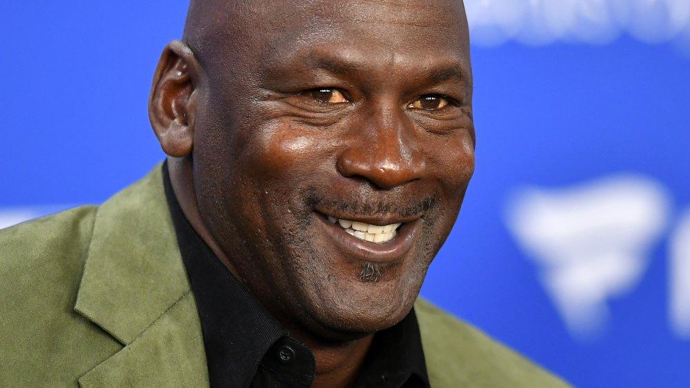 Michael Jordan smiling at a press conference before an NBA Paris game