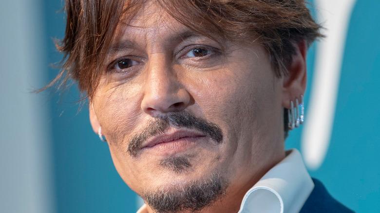 Johnny Depp wearing three earrings