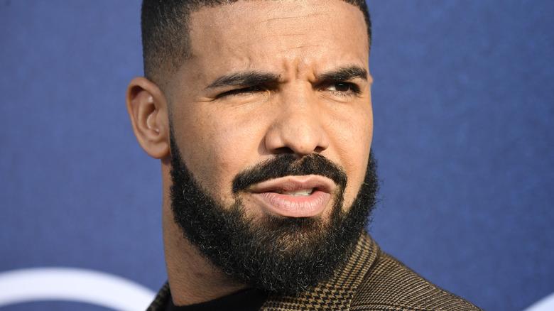 Drake looking away