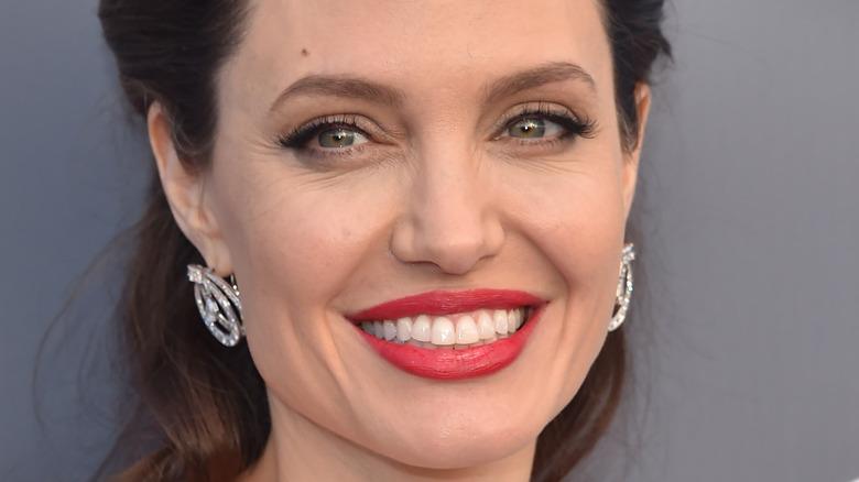Angelina Jolie smiles on red carpet