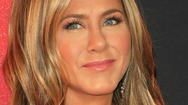 Jennifer Aniston slightly smiling and looking to the side
