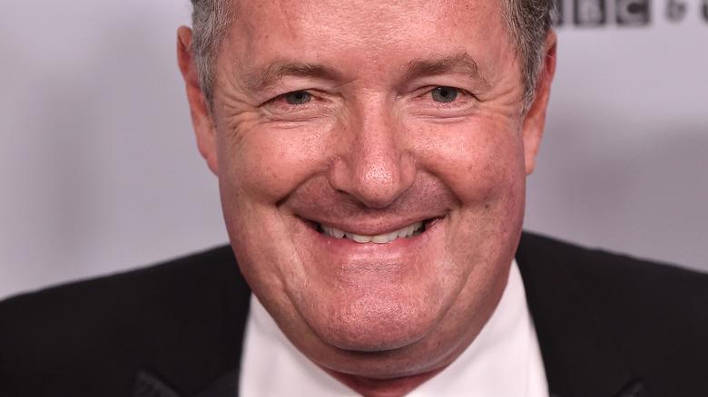 Piers Morgan smiling and looking at camera