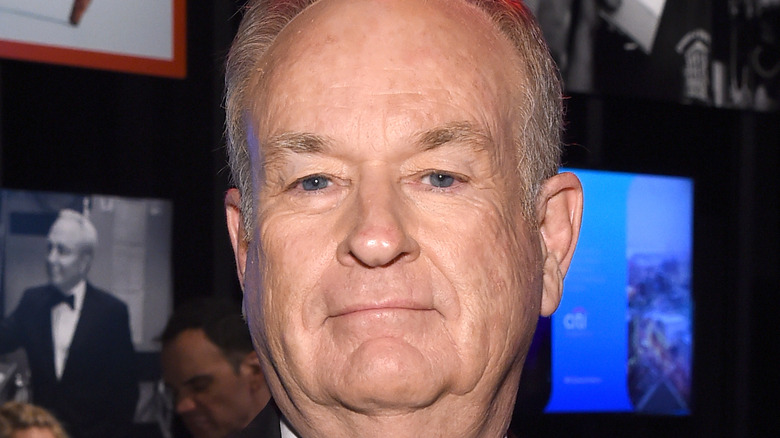 Bill O'Reilly smiling at camera with pursed lips