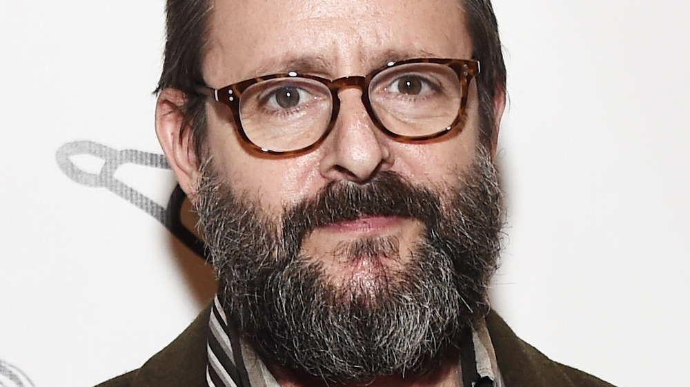 Judd Nelson beard and glasses close up