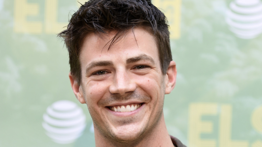 Grant Gustin smiling wide looking straight forward