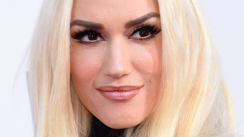 Gwen Stefani smirking and looking to the side