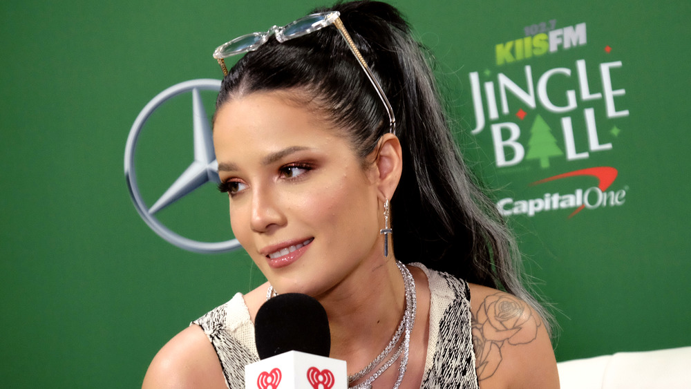 Halsey smiling with microphone