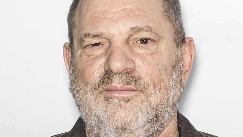 Harvey Weinstein poses