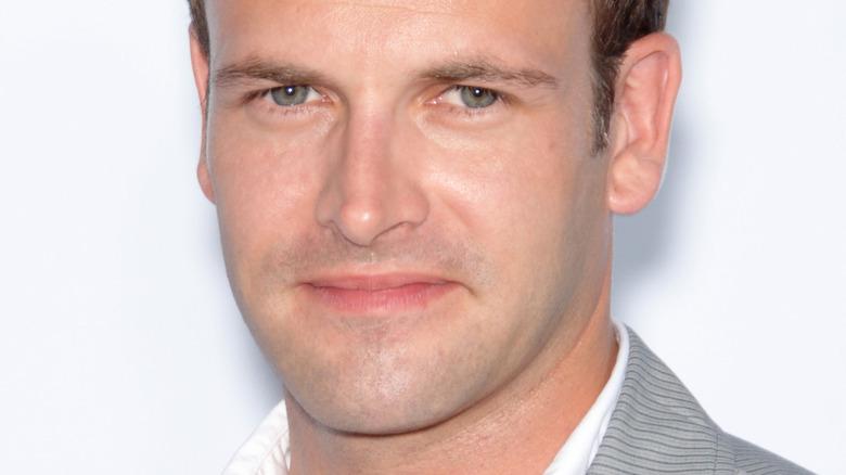 Jonny Lee Miller smiling on the red carpet