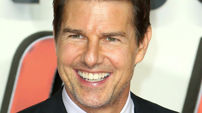 Tom Cruise grinning broadly