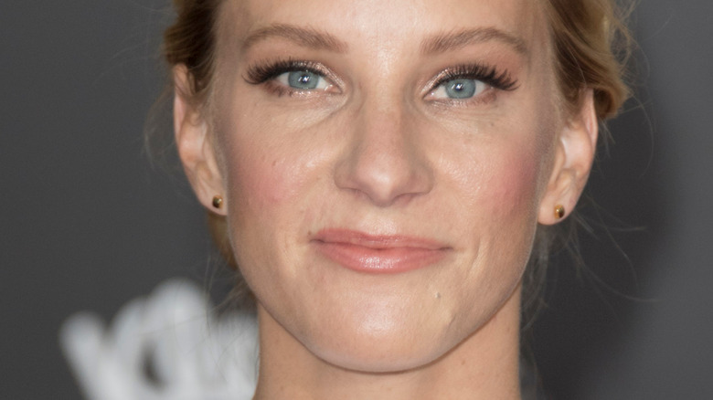 Heather Morris with slight smile on red carpet